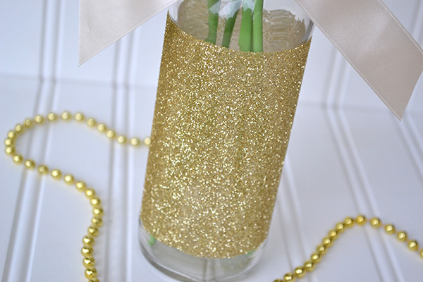 crepe paper flower bouquet with glitter covered bottle by aly dosdall
