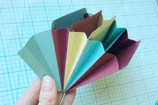 adhere accordion pockets together to form book