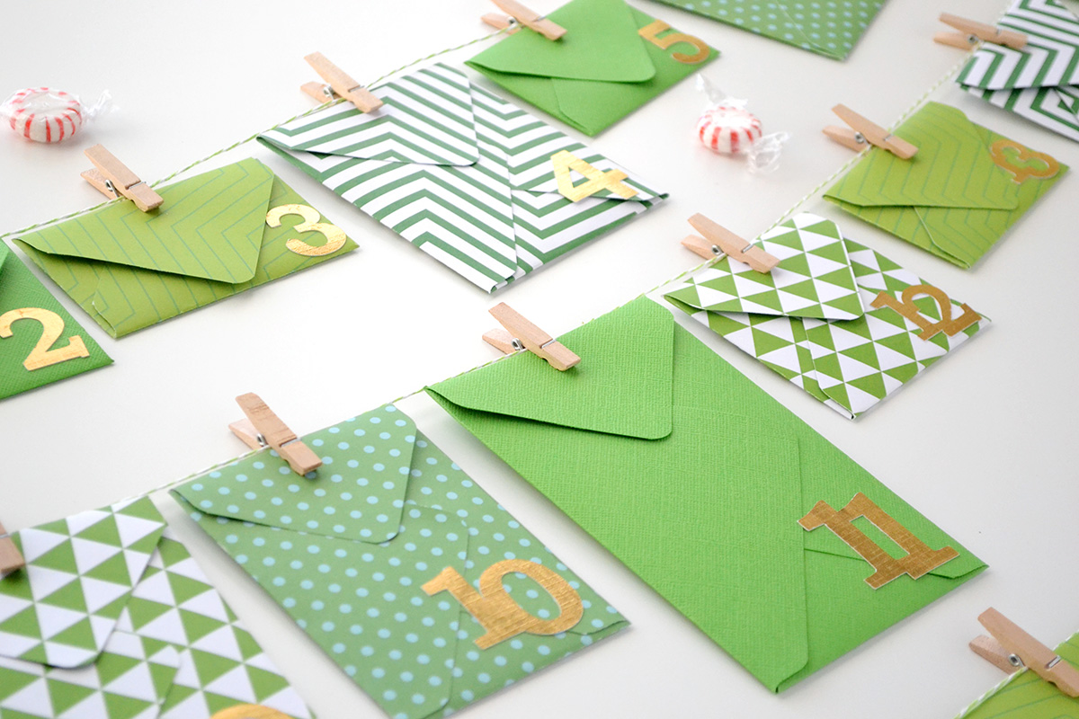 Envelope Advent Calendar by Aly Dosdall for We R Memory Keepers #envelopepunchboard #adventcalendar #christmascountdown #DIYholidays