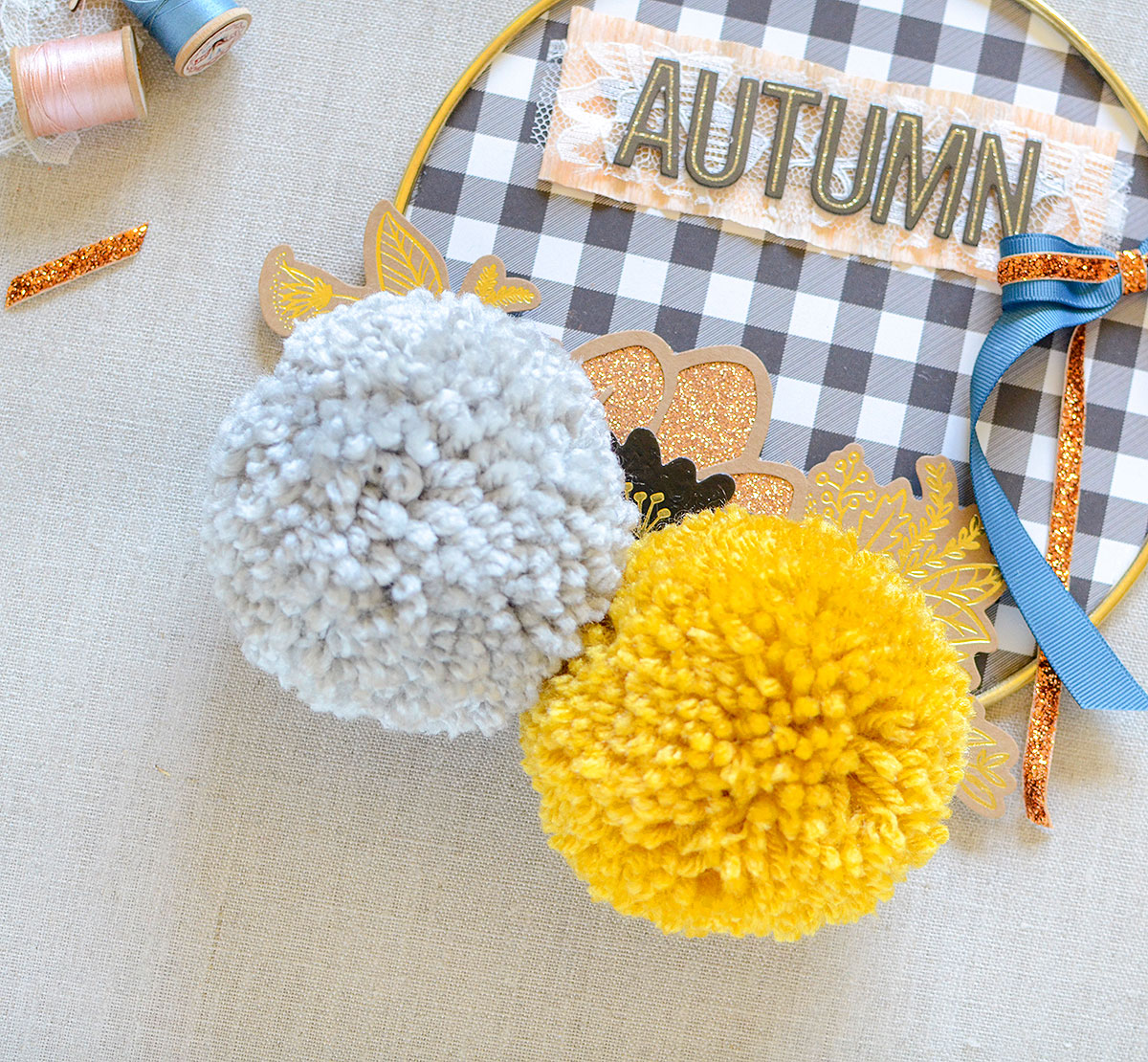 Autumn Hoop by Rebecca Luminaria for We R Memory Keepers featuring the Jumbo Pom Pom maker, Bow Loom, and Circle Spin & Trim