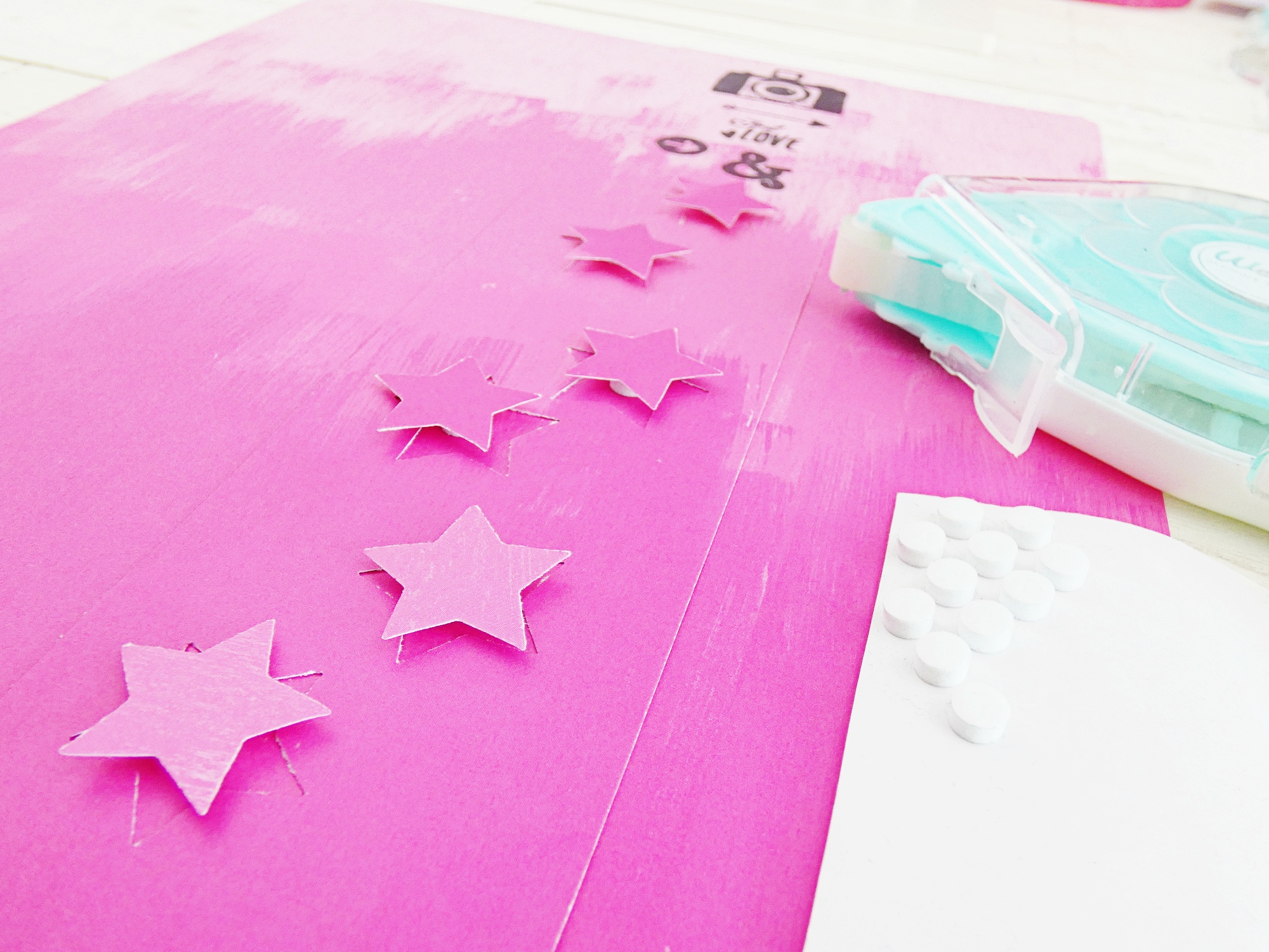 Make DIY scrapbook page embellishments with the We R Memory Keepers 1 Inch Clear Cut Star Punch