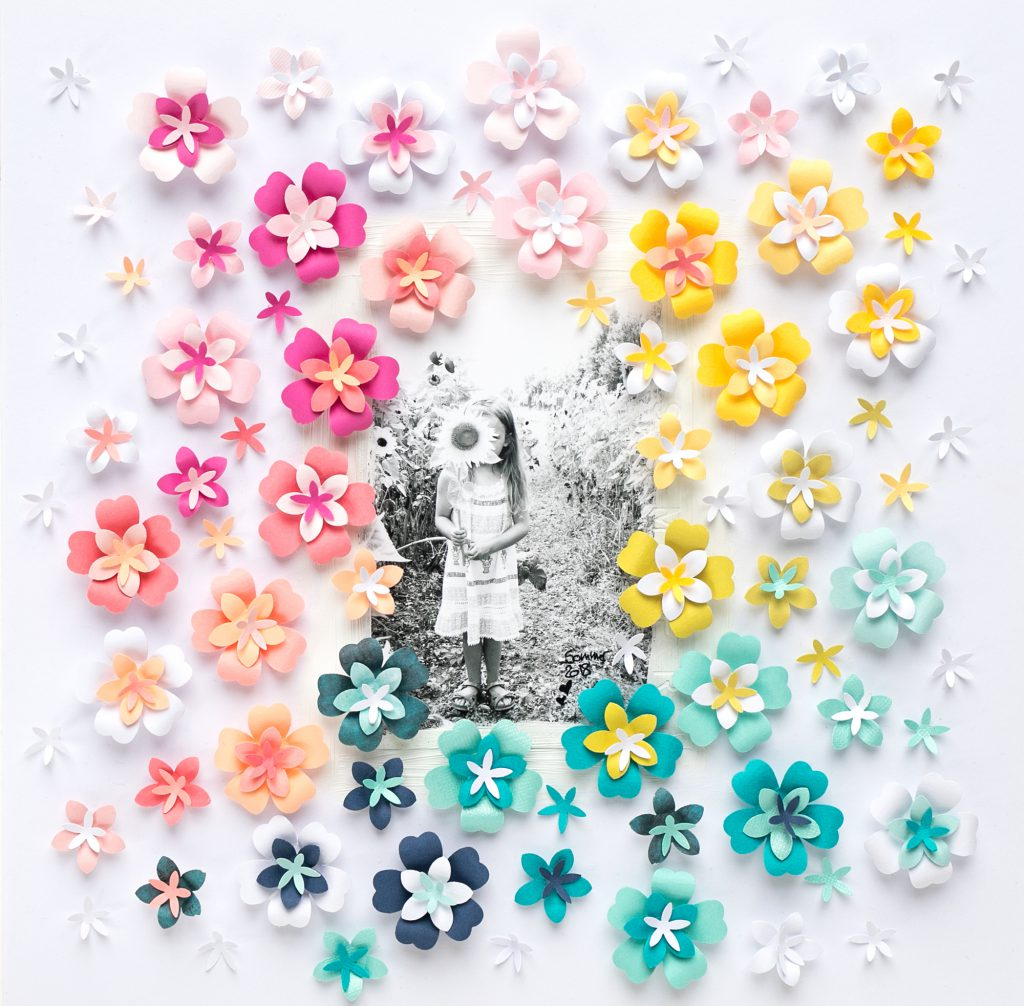 Make your own paper flowers on a scrapbook page with the We R Memory Keepers Flower Layered Punches!