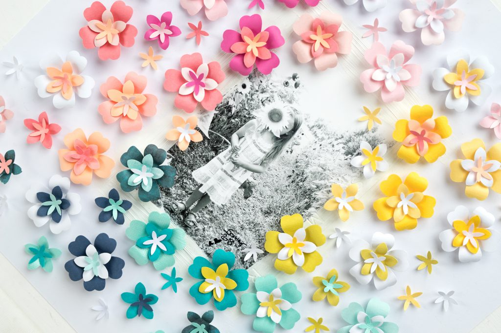 Make your own paper flowers for a scrapbook page with the We R Memory Keepers Flower Layered Punches!