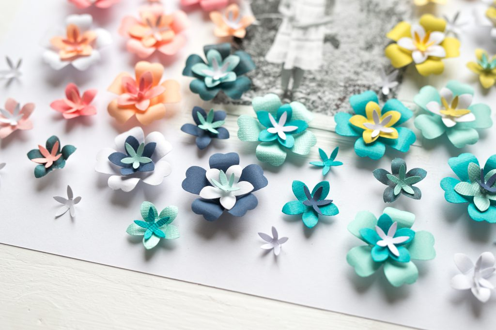 Make your own paper flowers with the We R Memory Keepers Flower Layered Punches!