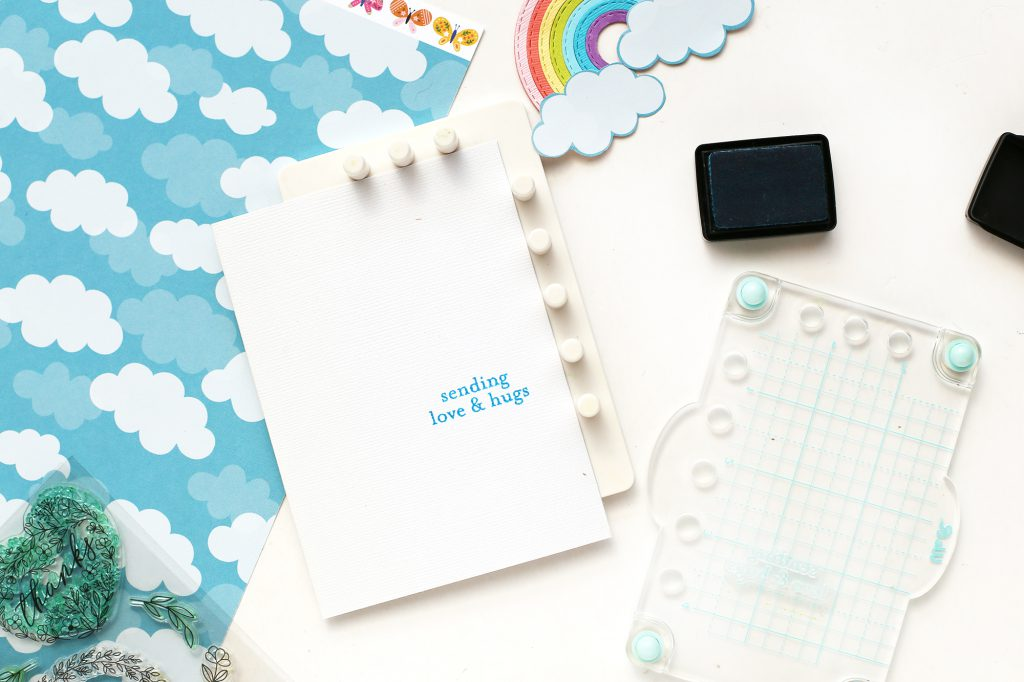 Learn how to make a rainbow handmade cards with the We R Memory Keepers Mini Evolution and the Mini Precision Press!