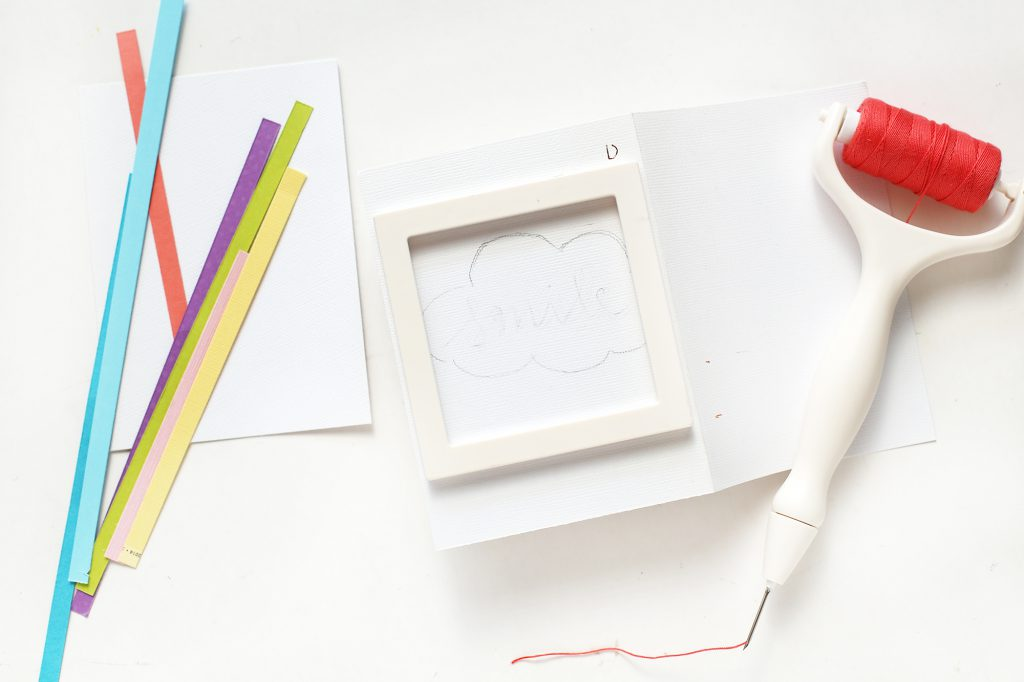 Learn how to make a rainbow handmade cards with the We R Memory Keepers Trim and Score Board and the Stitch Happy Pen!