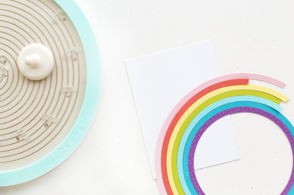 Learn how to make a rainbow handmade cards with the We R Memory Keepers Circle Spin & Trim.