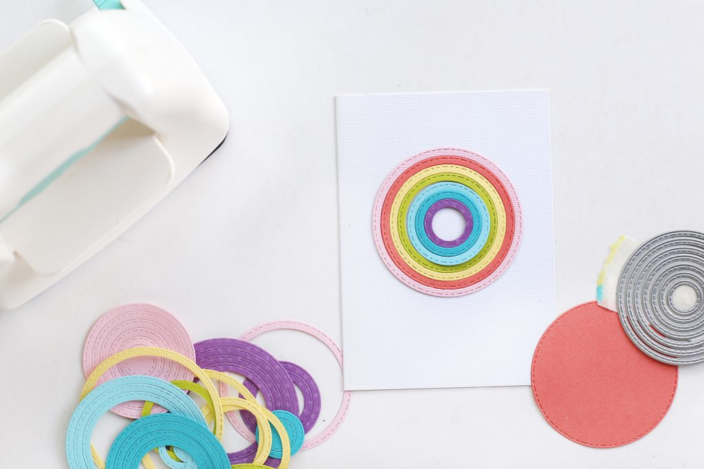 Learn how to make a rainbow handmade cards with the We R Memory Keepers Mini Evolution.