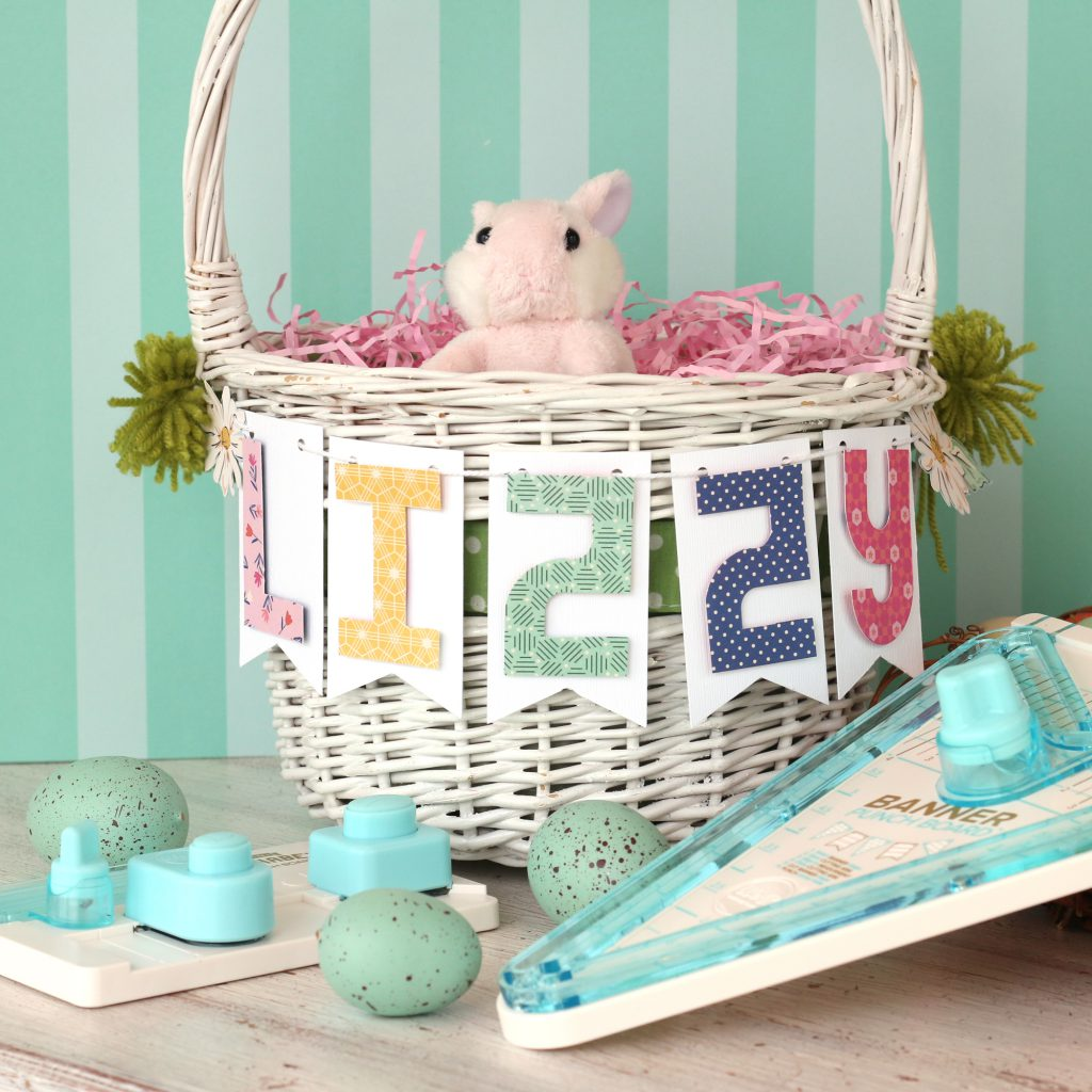 Learn how to use the We R Memory Keepers Banner Punch Board and the Mini Alphabet Punch Board to decorate an Easter basket!