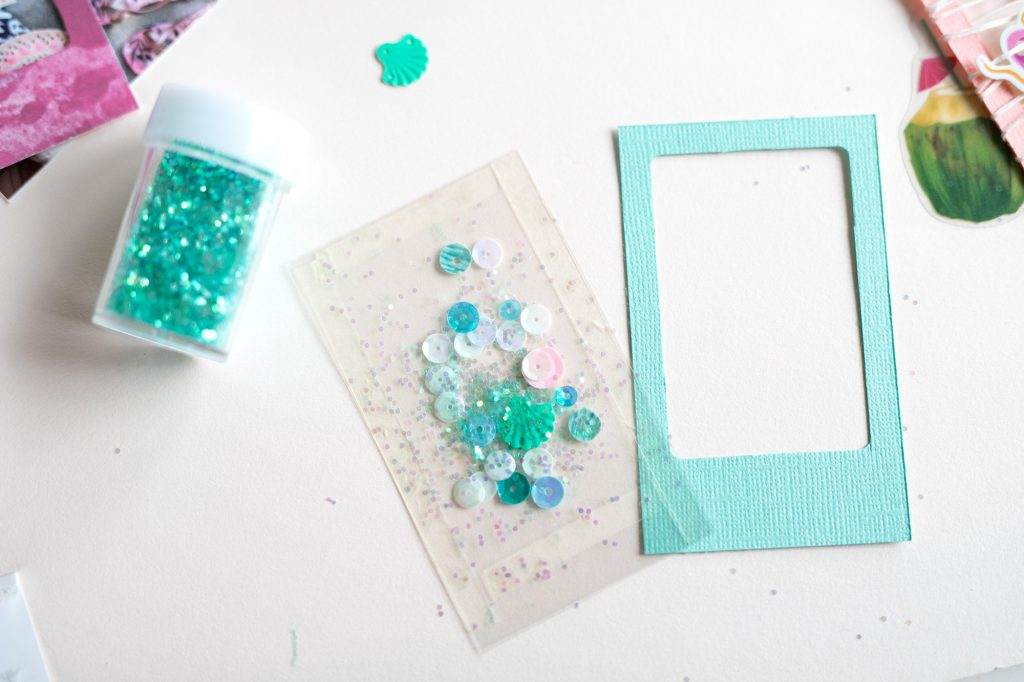 Make a summer mini album with the We R Memory Keepers Frame Punch Board available at Joann Stores!
