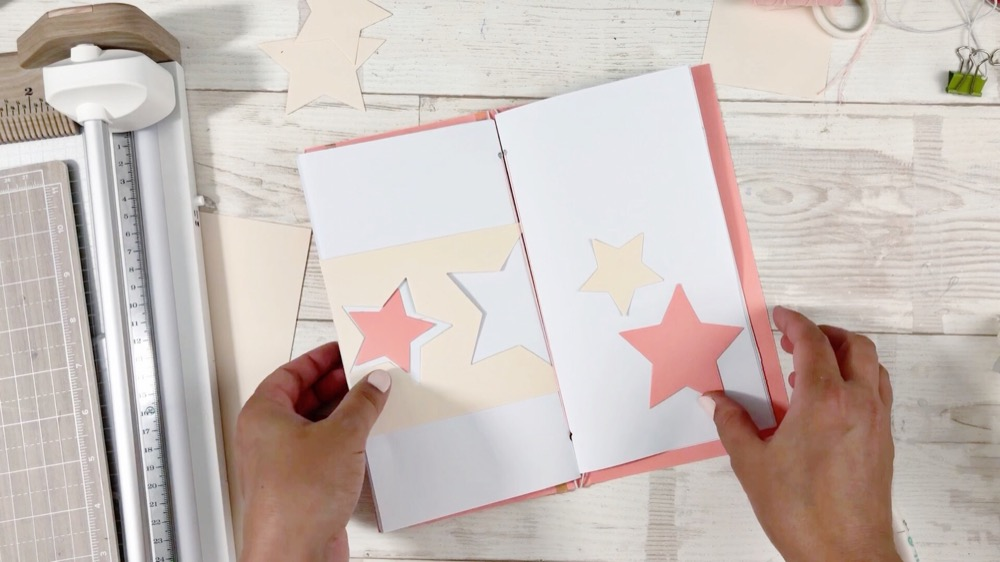 Use the Revolution Die Cutting & Embossing Machine to create Traveler's Notebooks with a unique shaker cover!