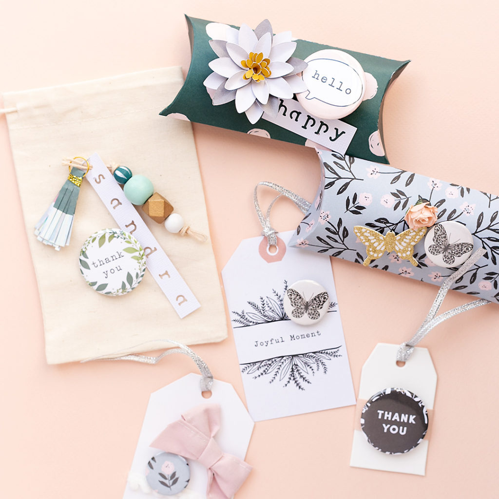 Wonderful gifts with the Button Press. Create pillow boxes, gift bags and tags with flairs and buttons.