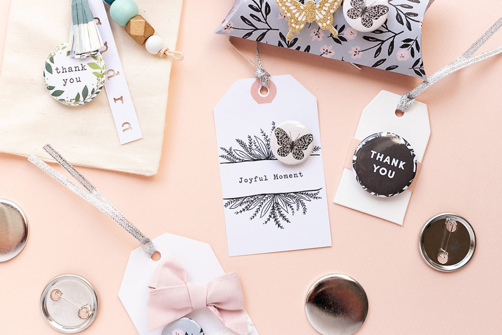 Three gift tags with flairs and a stylish bow. Say 'Thank you' in style