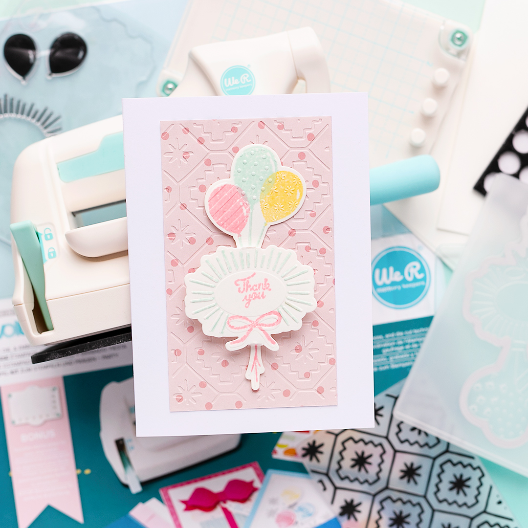 Thank you card by Sandra Dietrich on the Mini Evolution die-cutting machine. Layered stamping with balloons and fancy sentiment.
