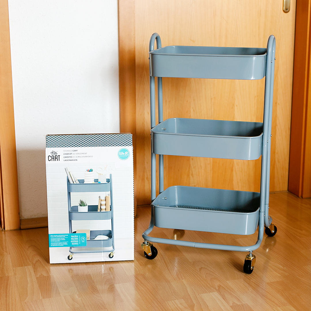 Steel blue A La Cart Storage Cart with the packaging on the left.