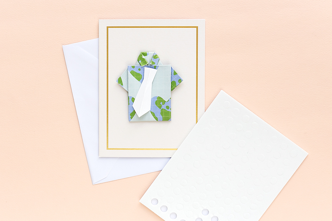 A shirt with a white tie on a card. Attach the tie with foam pads to create fancy Father's Day Cards with the All-In-One-Tool