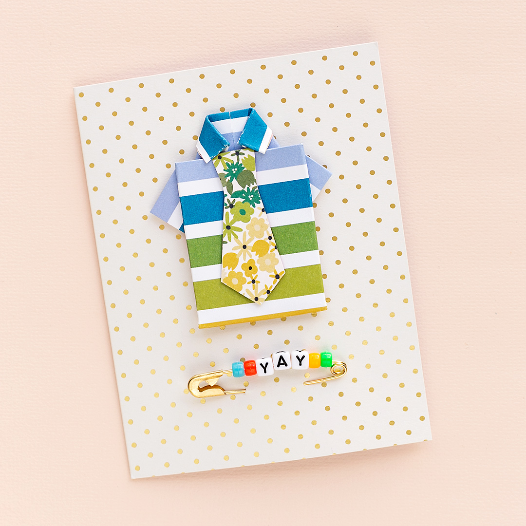 A cute Father's Day Card with a shirt with colorful stripes, a fancy tie, and an alphabet pin saying yay. WRMK Cardmaking inspiration