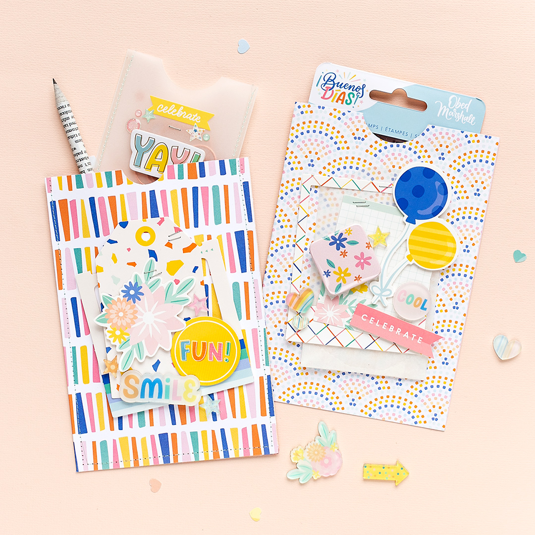 Two party goodie bags with colorful designs and layered embellishments: die-cut shapes, acrylic shapes, a flair button and die-cut frames. The bags were created with papers and embellishments from the Buenos Dias Collection (Obed Marshall for American Crafts).