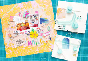 A scrapbook layout next to the Pocket Punch Board and the Tag Punch Board